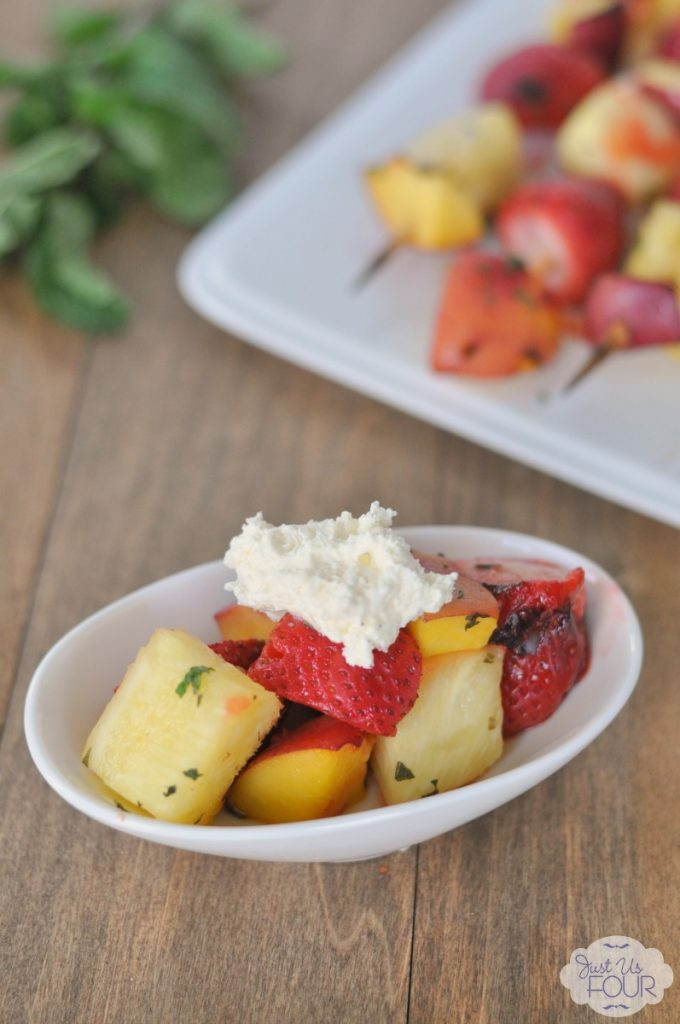 These citrus mint glazed fruit kabobs are the perfect summer treat! Love the idea to add a little bit of whipped cream too.
