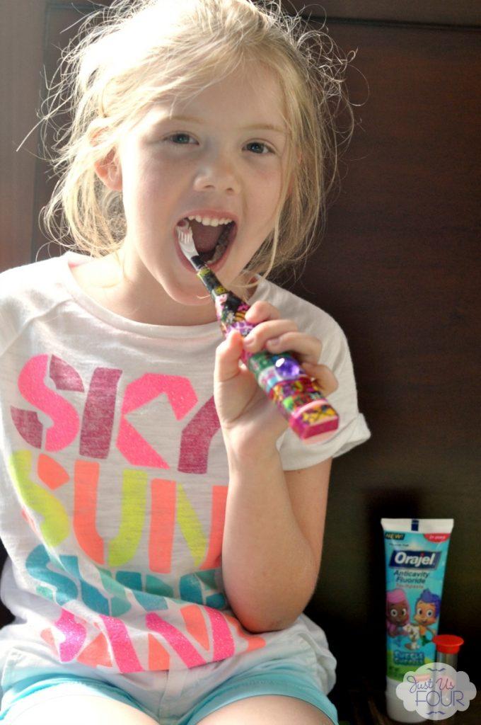 orajel-h-brushing-teeth-2_wm