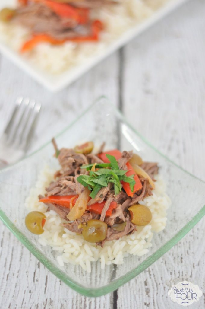 Crockpot season is here and this Cuban beef recipe is the PERFECT thing to make in the slow cooker. Even the kids will eat this one up.
