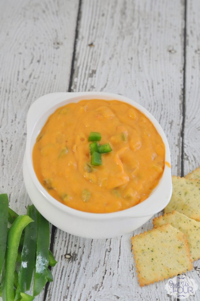 This pumpkin queso dip is THE BEST party dip I've had all year.
