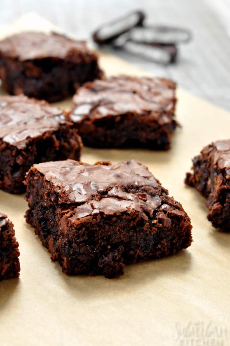 Photo of multiple brownies on parchment paper