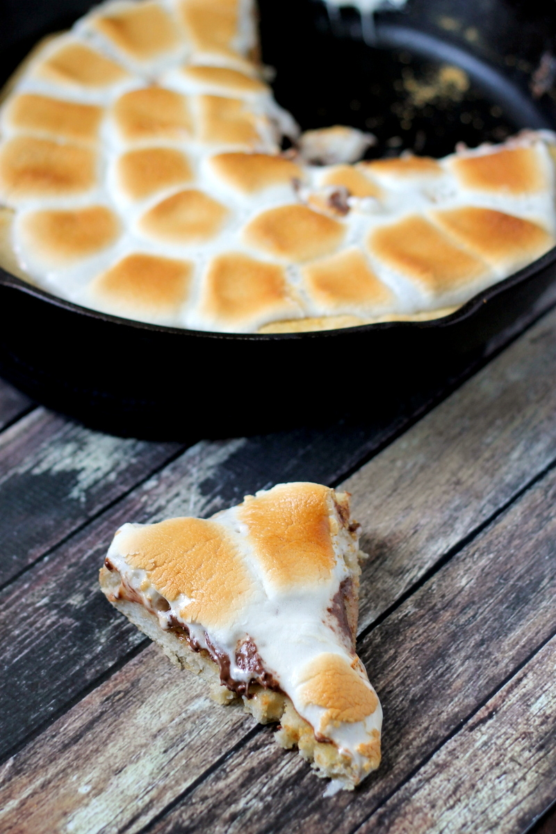 S'mores Pizza is the most amazing dessert you will ever make. Everyone will want a piece {or two}!