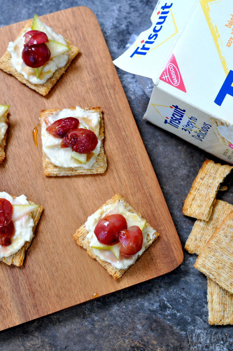 Spread a small amount of blue cheese on top of each TRISCUIT Hint ...