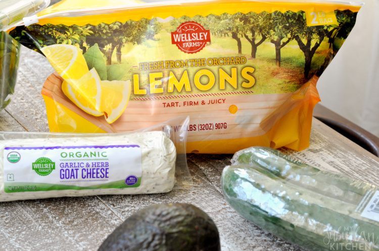 Green goddess vegetable sandwich ingredients - lemons, cucumber, avocado, goat cheese