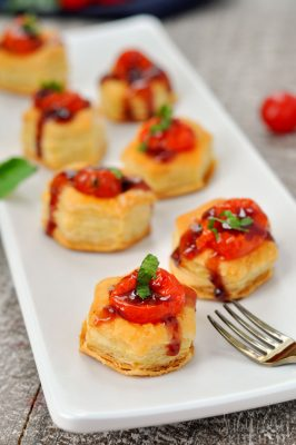Mini Caprese Appetizer on white serving plate with fork