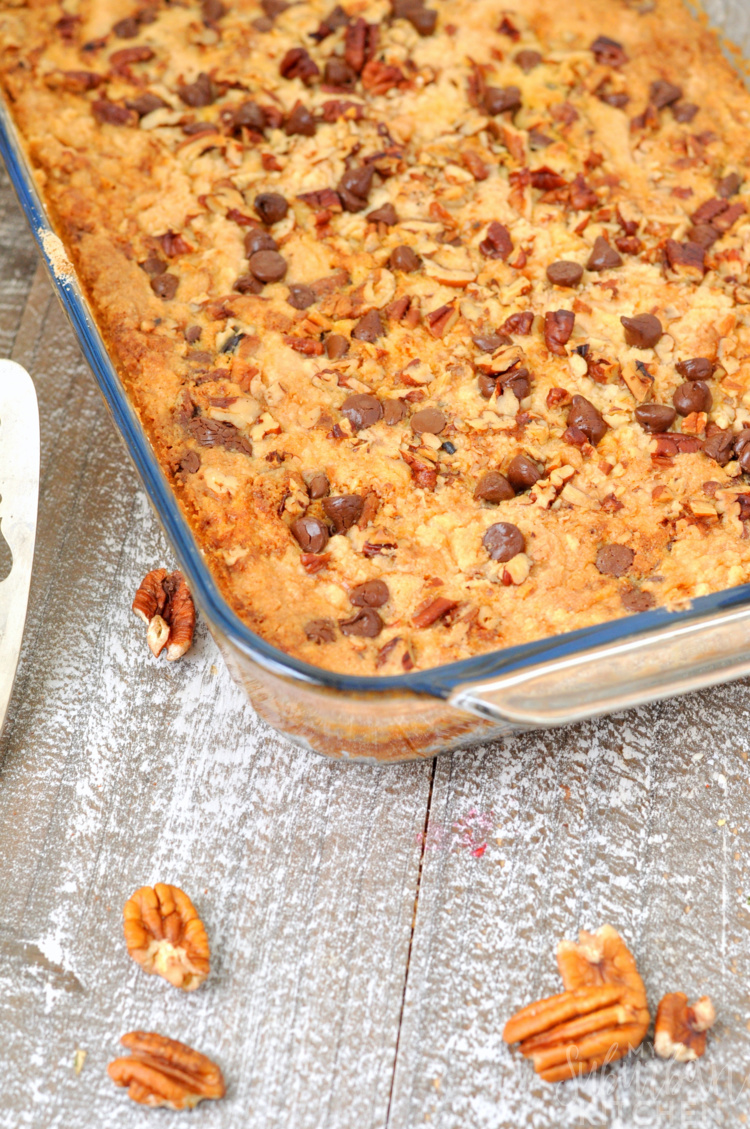 Chocolate Pumpkin Dump Cake in baking dish with pecans sprinkled around