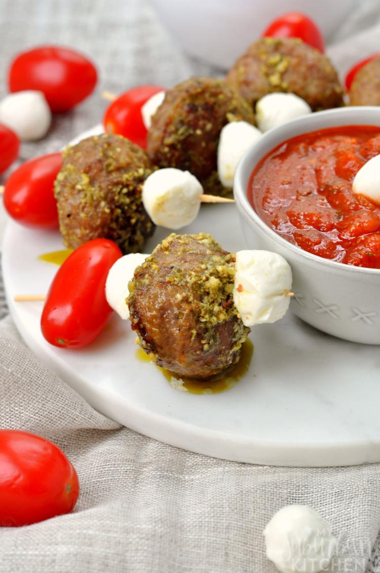 Photo of caprese meatball skewers on platter