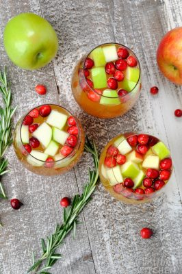 Overhead photo of three glasses of holiday sangria