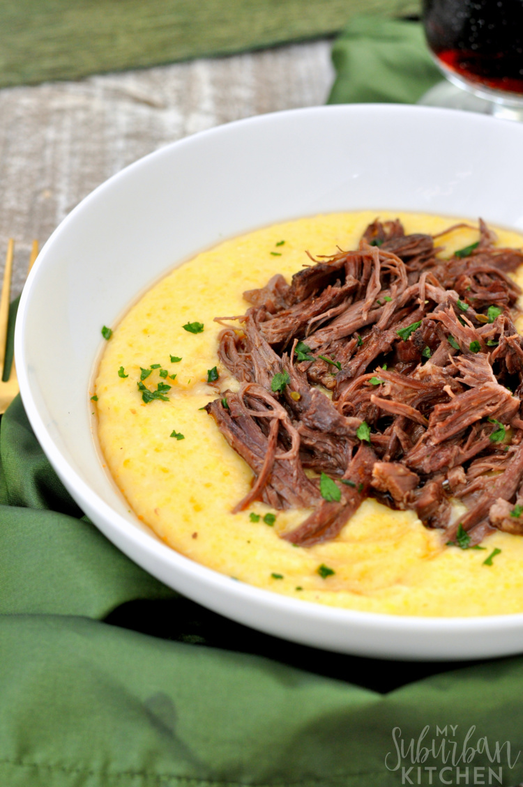 white bowl with polenta and red wine braised short ribs