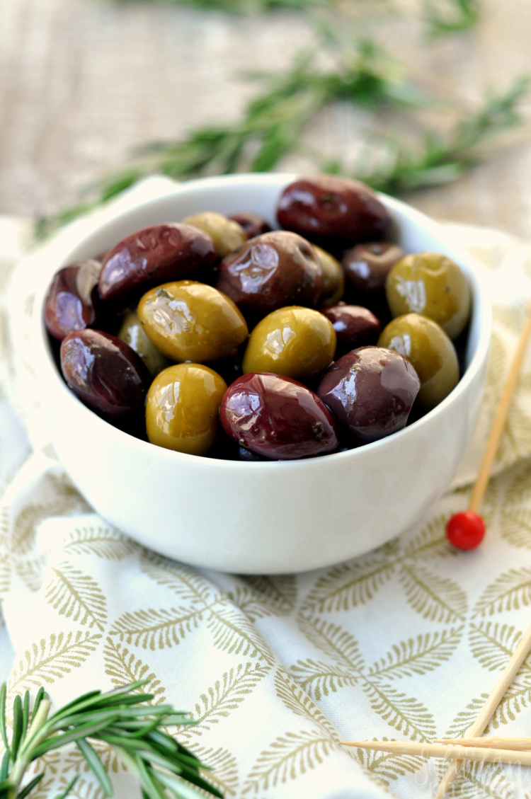 White bowl of mixed olives