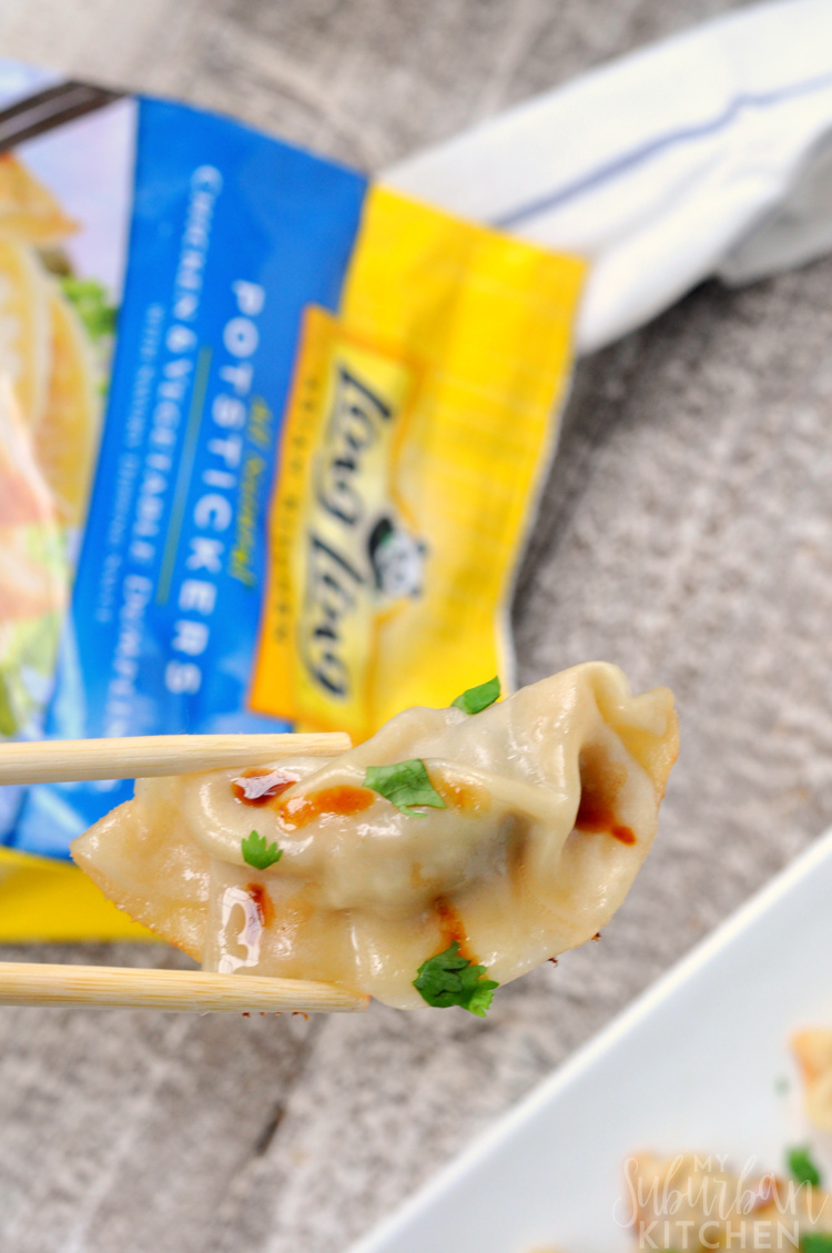 Photo of potsticker with chopsticks